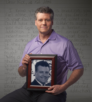 Rick holding a picture of himself from several years ago.
